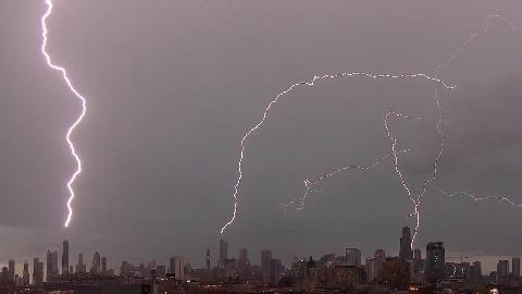 Simultaneous Lightning Strikes Illuminate Chicago Skyline