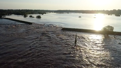 5276c19d465 Arkansas River Floodwaters Rush Through Failed Levee in Yell County